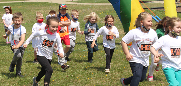 Photo of kids running during fun and field day
